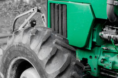 Close on a green tractor where you can see the hood, engine and large tractor tires. Campo Grande, MS, Brazil - September 14, 2016: Close on a green tractor Royalty Free Stock Photography