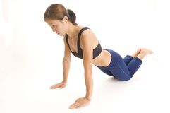Close-grip Push-up 2. A female fitness instructor demonstrates a close-grip push-up for the triceps royalty free stock image
