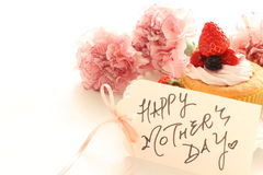 Close of of Homemade strawberry cup cake. With carnation and hand written greeting cake Stock Photography