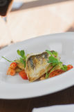 Close image of fish on dish with shrimps in restaurant. Image of tasty fish served in restaurant Stock Photo