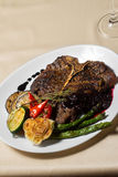 Close image of t-bone steak in restaurant Royalty Free Stock Photography
