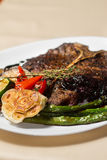 Close image of t-bone steak in restaurant Stock Image