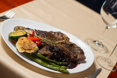 Close image of t-bone steak in restaurant Stock Photography