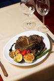 Close image of t-bone steak in restaurant Stock Photography