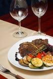 Close image of t-bone steak in restaurant Stock Photos