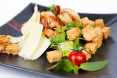 Close image of tasty cesar salad with shrimps Royalty Free Stock Image