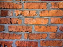 A close-up shot of a rough brick masonry wall lined with red clumsy brick for creativity, textures and background. Royalty Free Stock Photography