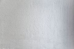 Rough light gray colored surface for backgrounds and textures. Royalty Free Stock Images