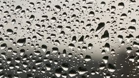 Close image with water drops on the window in a rainy day