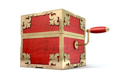 Close Jack-In-The-Box Antique. An ornate antique closed jack-in-the-box mad of red wood and gold trimmings on an isolated white studio background Royalty Free Stock Photography