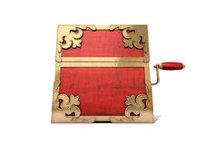Close Jack-In-The-Box Antique. An ornate antique closed jack-in-the-box mad of red wood and gold trimmings on an isolated white studio background Stock Photos