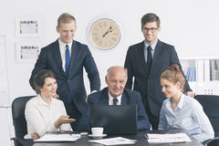 Close-knit business team at work Stock Image