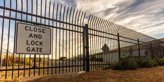 Close and Lock Gate. A locked gate blocks entry Royalty Free Stock Photos