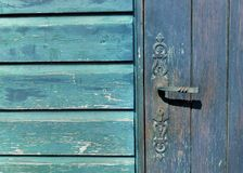 Lock handle of a  blue wooden door on blue wooden wall stock photos