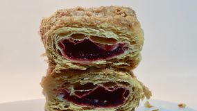 Close look at a good tasty raspberry cream puffs turnover stock photo