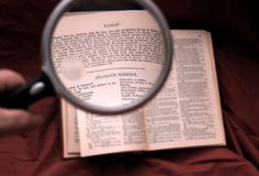 A Close Look At Hamlet. Using a magnifying glass to better read into Hamlet royalty free stock photography