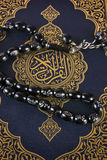 Close look for Quran and rosary Stock Images