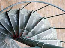 Close look at steps of a spiral metal staircase.  Stock Photography