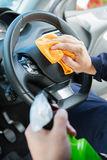 Close Of Man Cleaning Interior Of Car Royalty Free Stock Image