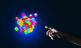 Idea of new technologies and integration presented by cube figure. Close of man hand holding cube figure as symbol of innovation. Mixed media Royalty Free Stock Photo