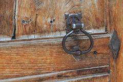 Close on metal  knock on an old wooden door royalty free stock photo