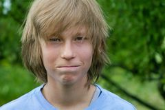 Close-Mouthed Teen Boy Stock Image