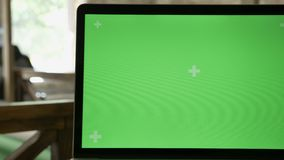 Close moving shot of laptop`s screen with chromakey in modern office stock video