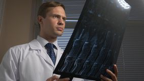 Close . MRI , x-ray images. the doctor analyzes the results of magnetic resonance therapy on film. Close . MRI x-ray images. the doctor analyzes the results of royalty free stock photos