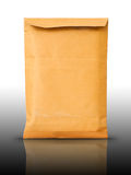 Close Old brown document envelope on reflect table Royalty Free Stock Images
