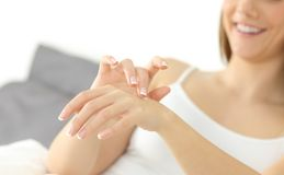 Happy woman hands applying moisturizer cream Royalty Free Stock Images