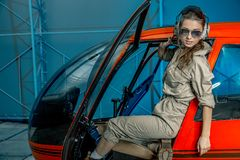 Close op portrait of Young woman helicopter pilot. royalty free stock photos