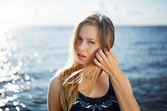 Close op of young woman posing on the beach Stock Image