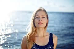 Close op of young woman posing on the beach Royalty Free Stock Image