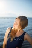 Close op of young woman posing on the beach Stock Photos