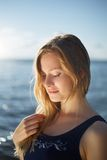 Close op of young woman posing on the beach Royalty Free Stock Images