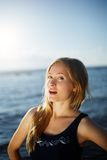 Close op of young woman posing on the beach Stock Images