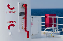 Close and open rotate red signs on deck of passenger ship Royalty Free Stock Photo
