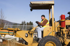 Close on Operator and Grader Stock Images
