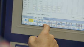 Close Operator Sets Program Tasks on Machine Touch Screen stock footage