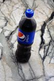 Close Pepsi drinks in a bottle on the supermarket shelf. Pepsi is a carbonated soft drink that is produced and produced by PepsiCo royalty free stock photos