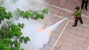 Close Petrol Burns in Vessel at Fire Brigade Exercises in Street. NHA TRANG, KHANH HOA/VIETNAM - MAY 28 2016: closeup upper view petrol burns with red flame stock footage