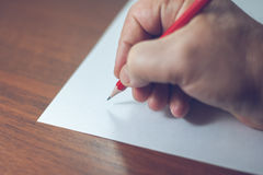 A close photo of a persons writing a letter with a pencil Royalty Free Stock Photo