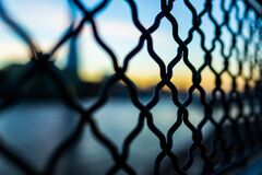 Close Photography and Tilt Lens of Black Chain Link Fence Stock Photo