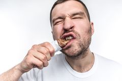 A close picture of guy eating sweet bar of chocolate with nouga. He is biting a big piece of this sweets. Young man is a. Fan of everythinf that is sweet stock photography