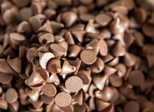 Close on on pile of chocolate morsels Royalty Free Stock Photography