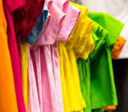 Close-pink T-shirt. Close-up of colorful T-shirt that hung to the retail shops of the bazaar Stock Images