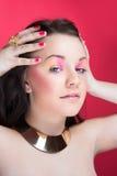 Close portait of beautiful girl with bright makeup Stock Photos