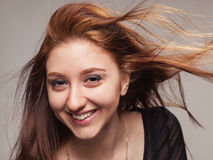 Close portrait of beautiful girl with fluttering h Royalty Free Stock Photo
