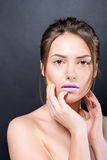 Close portrait of beautiful naked girl with bright makeup and manicure. Royalty Free Stock Photos