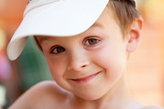 Close portrait of a boy with baseball cap Stock Photo